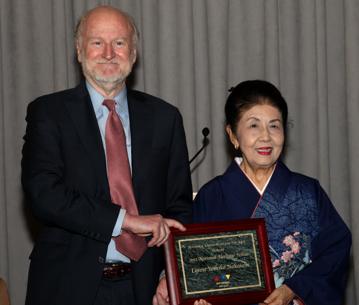 Lynne Yoshiko Nakasone receiving her award from NEA Chairman Rocco Landesman, 2012 National Heritage Fellowship Awards, Washington, D.C., Photograph by Michael G. Stewart