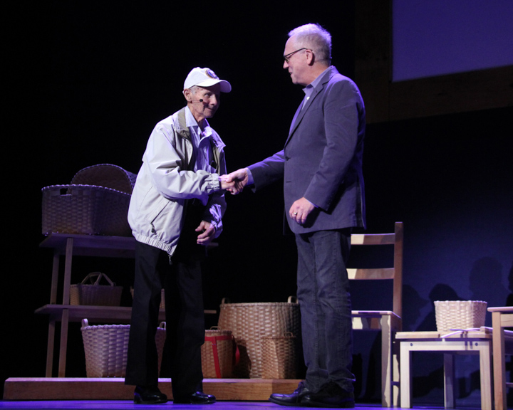 Henry Arquette shaking hands with Nicholas R. Spitzer at the 2014 National Heritage Fellowship Concert, Washington, D.C., photograph by Michael G. Stewart