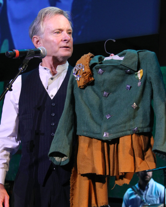 Kevin Doyle showing off his childhood uniform at the 2014 National Heritage Fellowship Concert, Washington, D.C., photograph by Michael G. Stewart