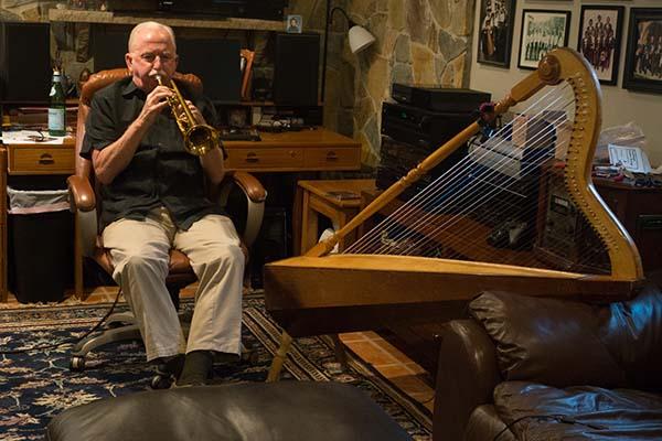 Daniel Sheehy playing the trumpet at his home in Falls Church, VA, Photograph by Alan Govenar, 2015.