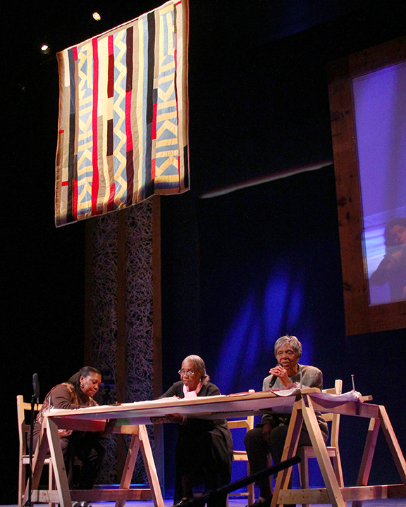 Claudine Pettway, Mary Lee Bendolph and Lucy Mingo giving a quilting demonstration at the 2015 National Heritage Fellowship Concert, Washington, D.C., Photograph by Michael G. Stewart.