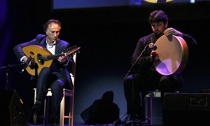 Rahim AlHaj performing at the 2015 National Heritage Fellowship Concert, Washington, D.C., photograph by Michael G. Stewart.