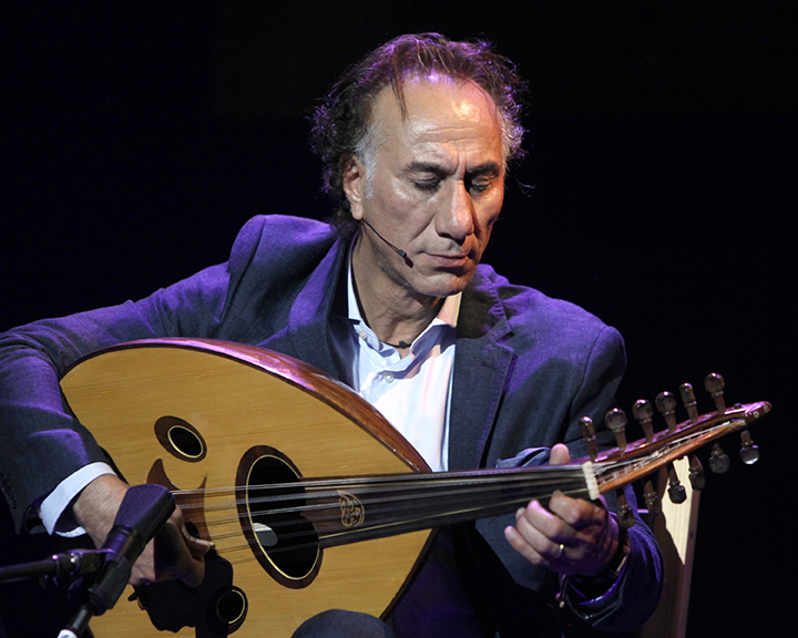 Rahim AlHaj playing his oud at the 2015 National Heritage Fellowship Concert, Washington, D.C., photograph by Michael G. Stewart.