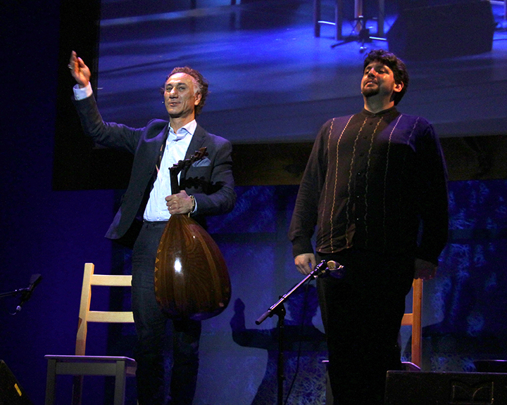 Rahim AlHaj taking a bow at the 2015 National Heritage Fellowship Concert, Washington, D.C., photograph Michael G. Stewart.