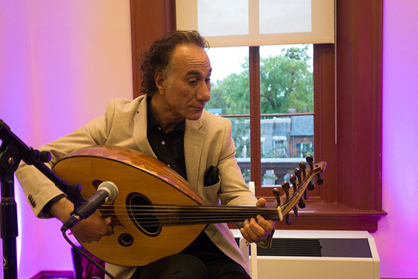 Rahim AlHaj performing at Hill Center, Washington, D.C., 2015, photograph by Alan Govenar.
