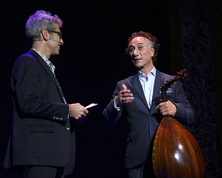 Marco Werman interviewing Rahim AlHaj at the 2015 National Heritage Fellowship Concert, Washington, D.C., photograph by Michael G. Stewart.