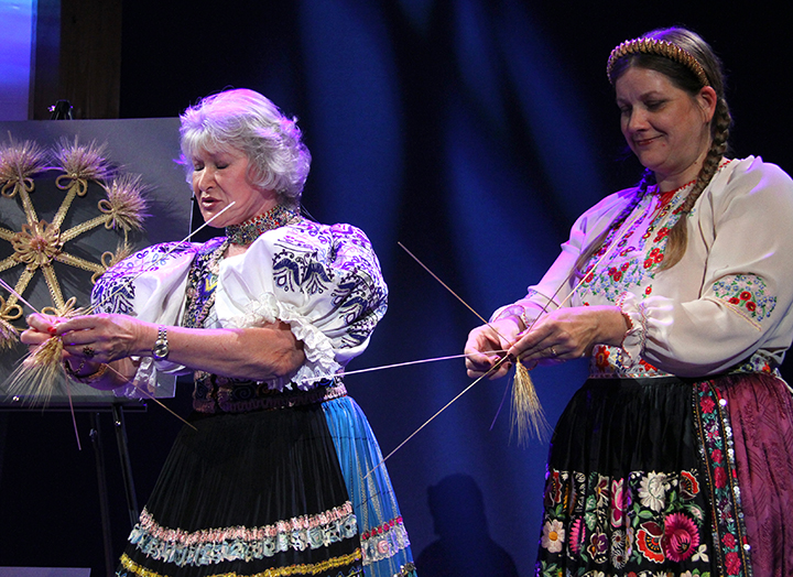 Sidonka Wadina and her daughter, Stephanie, weaving straw at the 2015 National Heritage Fellowship Concert, Washington, D.C., photograph by Michael G. Stewart.