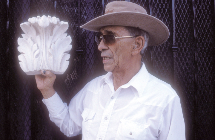 Earl Barthé with an example of his plaster work, courtesy National Endowment for the Arts
