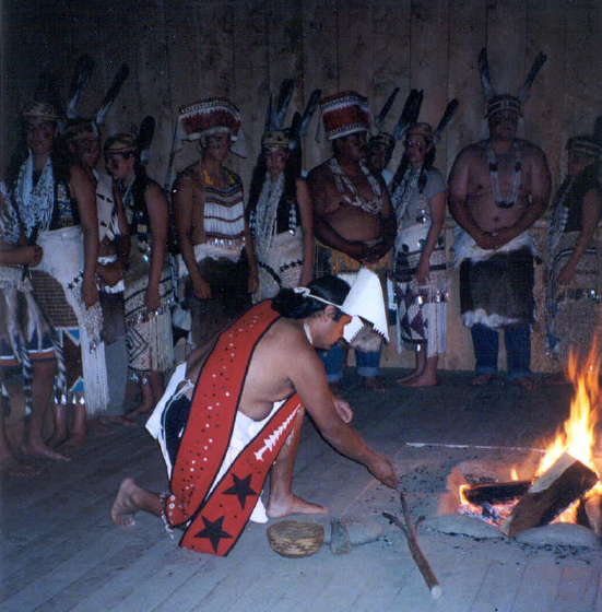 Loren Bommelyn offering a prayer at a Needash ceremony in the Dance House, courtesy Loren Bommelyn