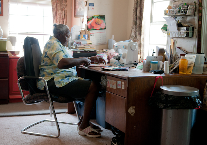 Laverne Brackens at work cutting pieces for a strip quilt, Fairfield, Texas, July 6, 2011, photograph by Alan Govenar