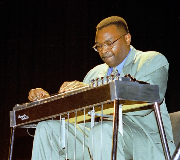 "Charles Campbell has been a major force in the popularity of sacred steel guitar playing, which until the early 1990s was unknown outside the African American churches where it provided a powerful, joyous voice. Recordings have inspired younger players and moved older musicians to start playing again. ""I'm telling you the tradition is alive and well,"" he says. Here he is playing for a concert in Pont St. Martin, Italy, 1999, photograph by Robert L. Stone"