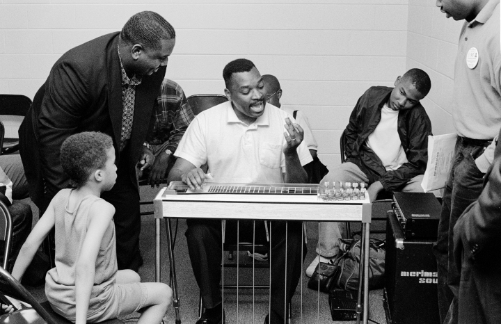 Charles Campbell gives Floridian Glenn Lee (1968-2000) some pointers at the House of God headquarters church, Nashville, Tennessee, 1995. Glenn Lee was the major pedal-steel influence among Florida House of God musicians. Photograph by Robert L. Stone