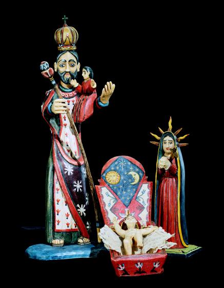 """San José con Niño bulto, 1993, (20"""" tall), Santo Niño de Nacimiento bulto, 1993, and Nuestra Señora de los Dolores bulto, 1993 (11"""" tall),  by Charles Carrillo, photograph by Robert Reck, courtesy of LPD Press and <www.nmsantos.com>"""