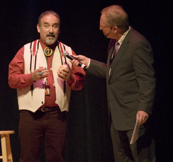 Charles Carrillo explains his carving of bultos to Nicholas R. Spitzer, 2006 National Heritage Fellowship Concert, Strathmore Music Center, Bethesda, Maryland, photograph by Alan Hatchett