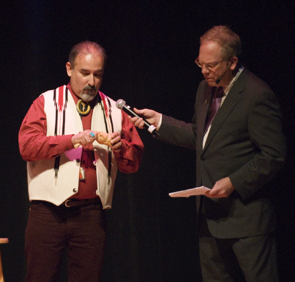 Charles Carrillo demonstrates the carving of bultos to Nicholas R. Spitzer, 2006 National Heritage Fellowship Concert, Strathmore Music Center, Bethesda, Maryland, photograph by Alan Hatchett