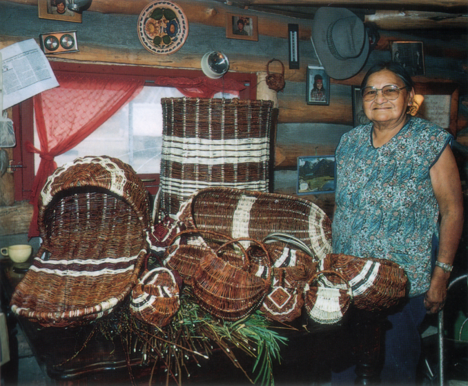 Rose Cree with a variety of willow basket shapes in her home, photograph by Chris Martin, courtesy North Dakota Council on the Arts
