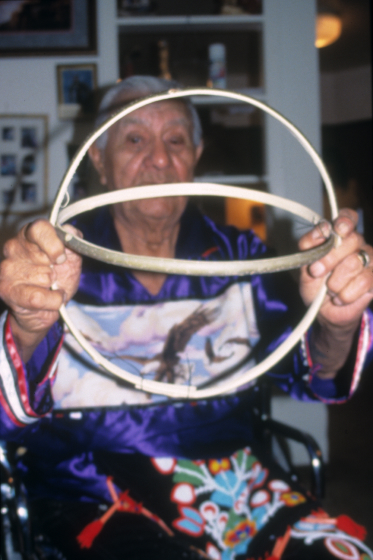 Francis Cree splits ash and shapes it to form the frame around which willow is woven. Turtle Mountain Indian Reservation, North Dakota, courtesy North Dakota Council on the Arts