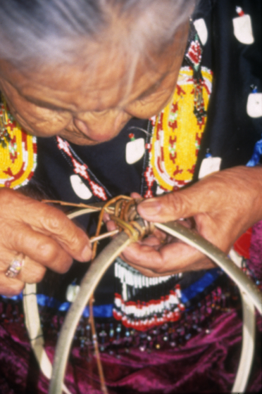 Rose Cree weaves willow to form a basket. By this time, in June 2002, Rose was legally blind, yet she still wove baskets, mostly by touch. Turtle Mountain Indian Reservation, North Dakota, courtesy North Dakota Council on the Arts