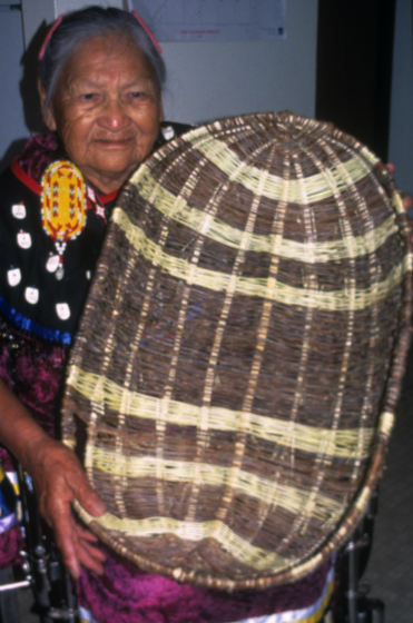 Rose Cree with a large willow laundry or burden basket, Turtle Mountain Indian Reservation, North Dakota, courtesy North Dakota Council on the Arts
