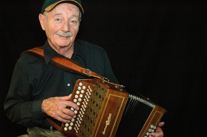 "Joe Derrane began his career playing diatonic button accordion but switched to piano accordion as the popularity of Boston's Irish dance halls faded. In 1994, he relearned the button accordion for a performance. He likened the experience to ""saying hello to an old friend"" and subsequently devoted himself to ""exploring the box in a way that I've never done before."" Arlington, Virginia, 2004, photograph by Alan Govenar"