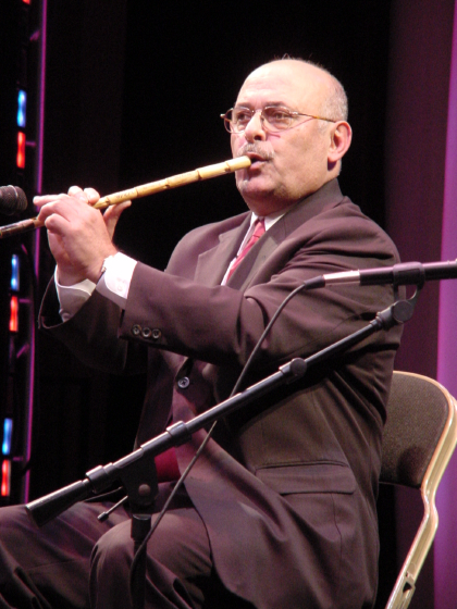 "Lebanese-born musician Nadim Dlaikan began learning to play the *nye*, a reed flute, when he was 9.  Now he lives in the Detroit area, where he performs and makes flutes for customers all over the United States. ""I love this instrument,"" he says. ""I feel like it's a part of my body,"" Washington, D.C., photograph by Marsha MacDowell, October 20, 2004. Courtesy of Michigan Traditional Arts Program, Michigan State University Museum"