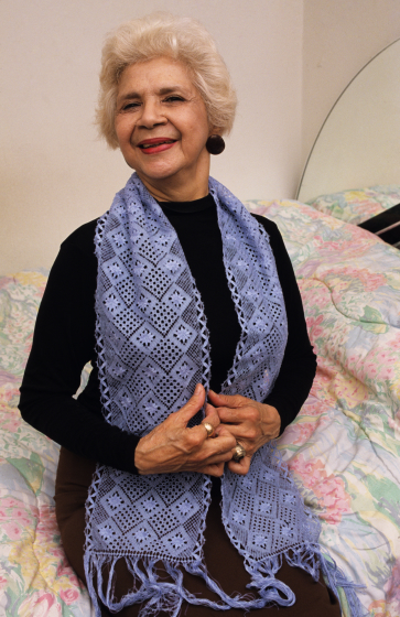 Rosa Elena Egipciaco wearing lace scarf, courtesy National Endowment for the Arts