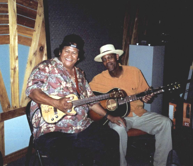 Ledward with Eric Bibb at the Edmonton Folk Festival, 2002, courtesy Ledward Kaapana