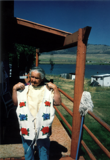 Agnes 'Oshanee' Kenmille with a hand-crafted vest, Roslyn, Virginia, 2003, photograph by Alan Govenar