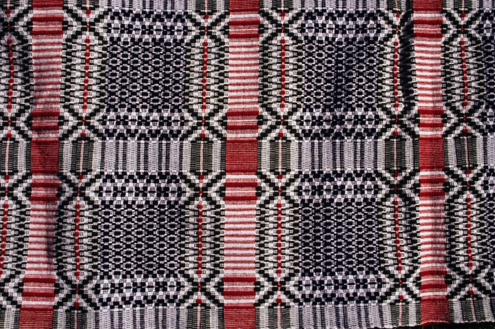 Overshot coverlet by Norman Kennedy, Governor's Garden pattern, cotton warp set at 30 threads per inch, handspun wool weft, hand-dyed with indigo, courtesy National Endowment for the Arts