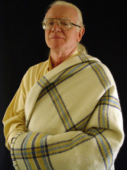 Norman Kennedy wearing one of his hand-woven blankets, Arlington, Virginia, 2003, photograph by Alan Govenar