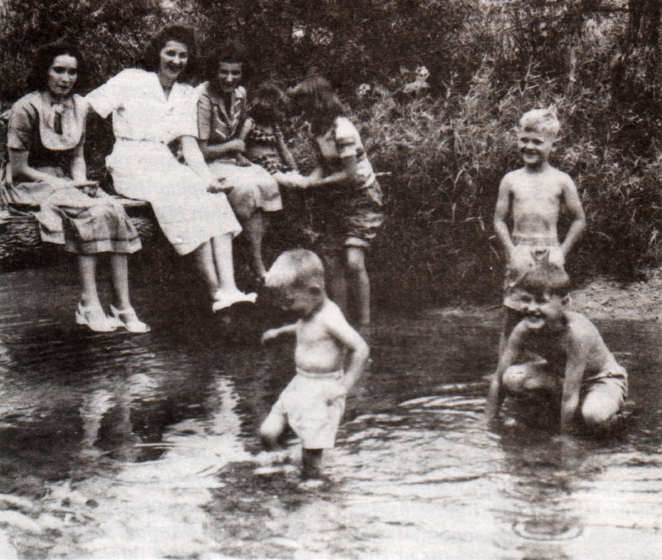 Susie, Lily May and Rosie Ledford; Lily May's children Jimmy (wading) and Barbara; Rosie's Lois, Clyde (standing) and C.V. Jr. Courtesy Berea College Appalachian Center