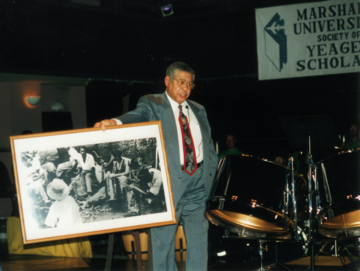 Elliot Mannette lectures in the late 1990s in Marshall University's prestigious Yeager Scholarship lecture series. Photograph by Kaethe George, courtesy Mannette/George Private Archival Collection