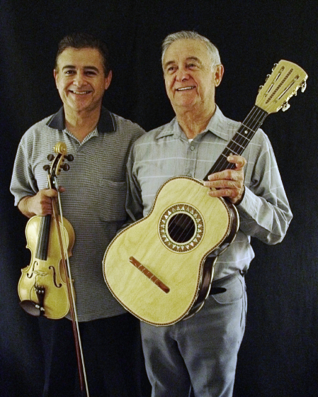 "Father-and-son mariachi musicians Roberto and Lorenzo Martinez began playing together in Los Reyes de Albuquerque when Lorenzo was 15. Roberto Martinez composed topical ballads known as *corridos* and founded two record labels. After retiring from a government job, he took his music to senior citizen centers and social service agencies in northern New Mexico, where people told him, ""You give me pride in what I am."" Arlington, Virginia, 2003. photograph by Alan Govenar"