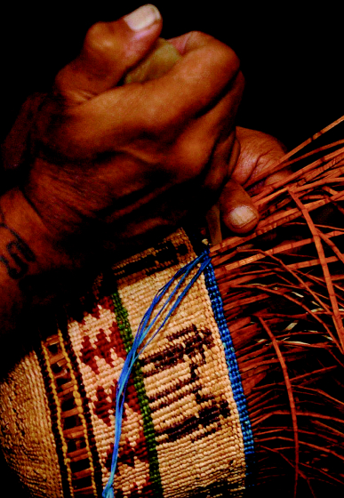 Gerald Bruce 'Subiyay' Miller working on a basket, courtesy National Endowment for the Arts