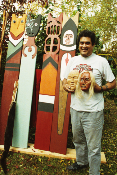 Gerald Bruce 'Subiyay' Miller with his hand-crafted totems and masks, photograph by Karen James, courtesy National Endowment for the Arts