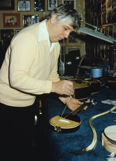 Milan Opacich stringing up a new instrument, 1982, photograph courtesy *South Bend Tribune*