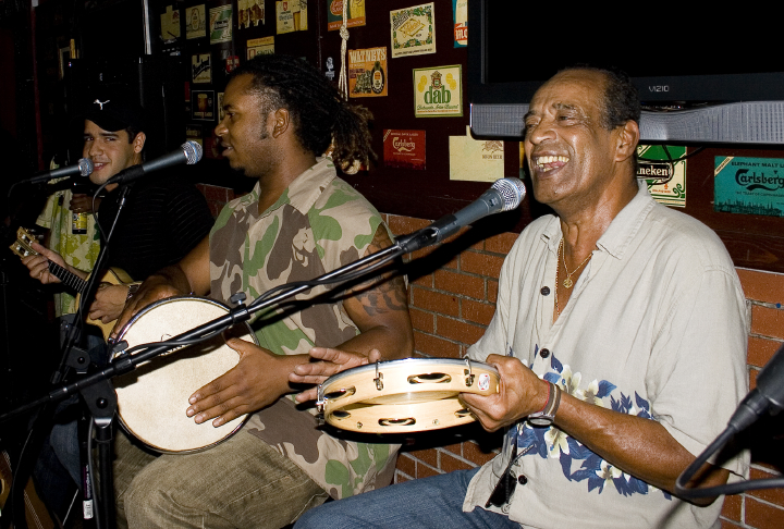 Carlinhos Pandeiro de Ouro performing with Vinicius Moreira and Fernando Ebano in Santa Monica, California, 2008, photograph by Roger Poirier