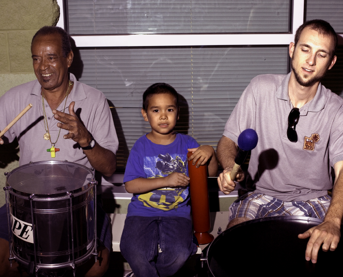 Carlinhos Pandeiro de Ouro and Simon Carroll teaching percussion for the Summer Night Lights program, Los Angeles, 2009, photograph by Roger Poirier