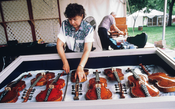Ron Poast and his wife, Joyce, at his instrument-making stand at the Smithsonian Folklife Festival, 1998, courtesy National Endowment for the Arts