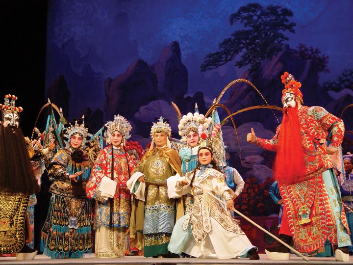The finale of the 'Women Generals of the Yang Family' (left to right) Yucheng Ren as Jiao Tinggui, Lianzhi Ma as Seven Wido, Cun Yu as Princess Cai, Qiuwei Zhang as She Tai Jun, Qi Shu Fang as Mu Gui Ying, Xinling Yuan as Yang Wen Guang and Ye Zhang as Meng Huai Yuan, New York, 2002, photograph by Alan Govenar