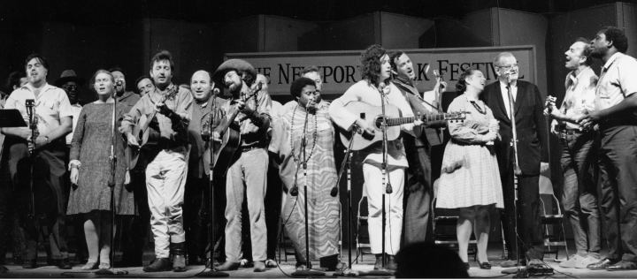 Newport Folk Festival Finale, (left to right) Alan Lomax, Jean Ritchie, Theo Bikel, Bruce Jackson, Logan English, George Wein, Ramblin' Jack Elliott Bernice Reagon, Arlo Guthrie, Oscar Brand, Bess Lomax Hawes, Lee Hayes, Pete Seeger, the Reverend Frederick Douglass Kirkpatrick. Courtesy Jean Ritchie and George Pickow