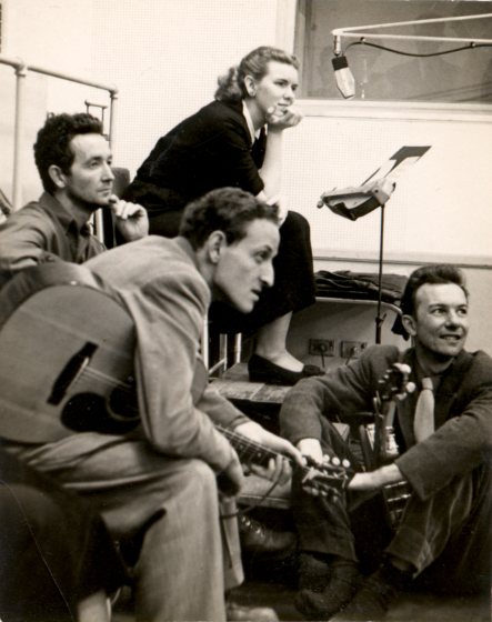 Fred Hellerman (front), then left to right, Woody Guthrie, Jean Ritchie, Pete Seeger, at an Oscar Brand Folksong Festival broadcast, WNYC, New York City, ca.1948. Courtesy Jean Ritchie and George Pickow