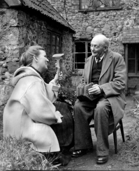 Jean Ritchie visits with Mr. Rew, a gardener and musician, while collecting traditional music in England during her Fulbright year in the British Isles. Courtesy Jean Ritchie and George Pickow