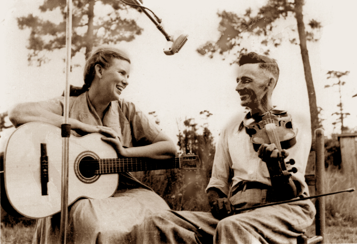On an early collecting trip, soon after her marriage to George Pickow, Jean Ritchie talks and sings with Ivey Scott of Harker's Island, North Carolina, ca. 1950, courtesy Jean Ritchie and George Pickow