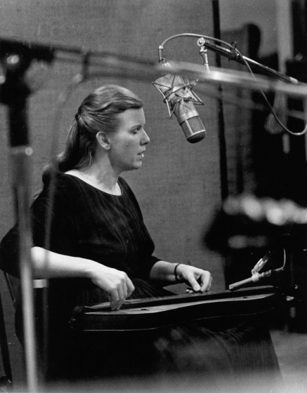 Jean Ritchie making an early recording, probably for her album, *A Time For Singing*, originally released by Warner Brothers. Now available on a Warner Brothers/Rhino reissue, a CD box set, *Mountain Hearth & Home*