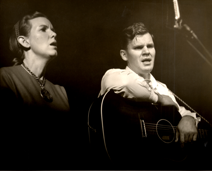 Jean Ritchie and Doc Watson at Folk City in Greenwich Village, 1962. About this photograph, Ritchie said, 'This was Doc's first solo performance since he had left Clarence Ashley's band. Ralph Rinzler, then Doc's manager, asked me to share the gig with him, so he 'wouldn't get nervous.' Courtesy Jean Ritchie and George Pickow