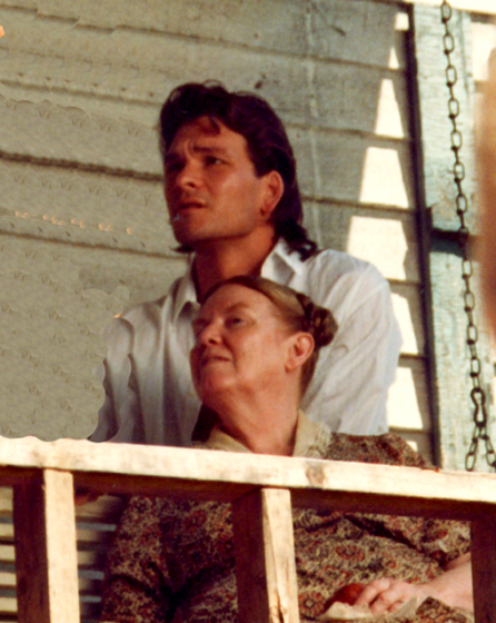 Jean Ritchie and Patrick Swayze. About this photograph, Jean Ritchie said, 'The film starring Patrick Swayze, *Next of Kin*, was shot partially in Hazard, Kentucky, near to my birthplace, Viper Kentucky. George and I were spending time at our cabin there, and a friend asked us to go with him to the casting session in Hazard; director John Irvin talked with us and gave me the part of 'Aunt Charlene' in the movie! PS: I didn't especially like the script, but being a part of a Hollywood movie was an experience I had never had, I thought I'd like to see what it was like, and because it was set in my own part of Appalachia, the coal camp at Hardburly, a few miles from my home.' Courtesy Jean Ritchie and George Pickow