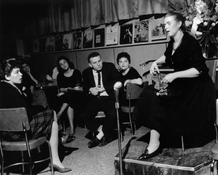 Jean Ritchie doing her set at opening night at Folk City, in Greenwich Village, New York City, photograph by George Pickow, courtesy Jean Ritchie and George Pickow