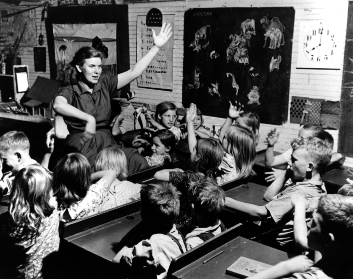 About this photograph, Jean Ritchie said, 'After graduation from [the University of Kentucky], for a short time I worked out of the county school superintendent's office, as recreation director for all the one-room schools in the area. Here we're doing one of the children's favorite action songs.' Photograph by George Pickow, courtesy Jean Ritchie and George Pickow