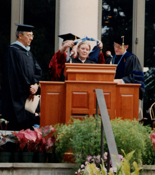 About this photograph, Jean Ritchie said, 'Good friend Loyal Jones gave me his arm for the ceremony. Berea College gave an honorary doctor of arts degree; my previous one was from [the University of Kentucky], honorary doctor of letters. At Berea, George gave me the title 'Doctor-Doctor.'' Photograph by George Pickow, courtesy Jean Ritchie and George Pickow